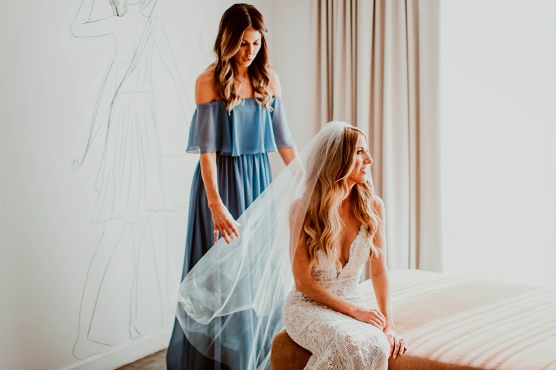 A Maid of Honor Placing the Veil