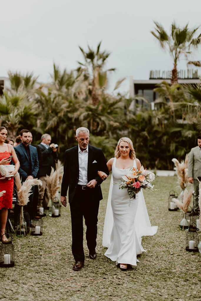 Maggie walking the Aisle